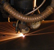Dymond Engineering - Cutting metal with Mazak CNC Laser